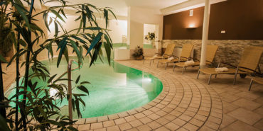 swimming pool, an indoor pool in the spa, in Christophs Wellness Hotel in Schenna